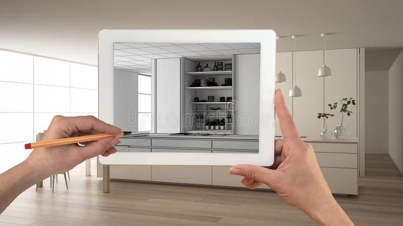 M?os que guardam e que tiram na tabuleta que mostra a cozinha branca moderna com esbo?o de madeira do CAD dos detalhes Interior t ilustração royalty free