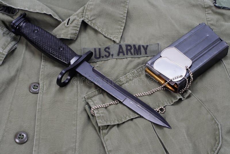 M16 rifle bayonet on uniform. Background royalty free stock photos