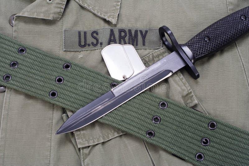 M16 rifle bayonet on uniform. Background stock photography