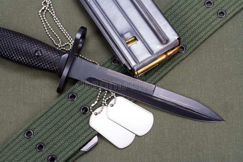 M16 rifle bayonet on uniform. Background stock image
