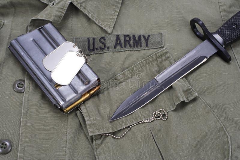 M16 rifle bayonet on uniform. Background royalty free stock photo
