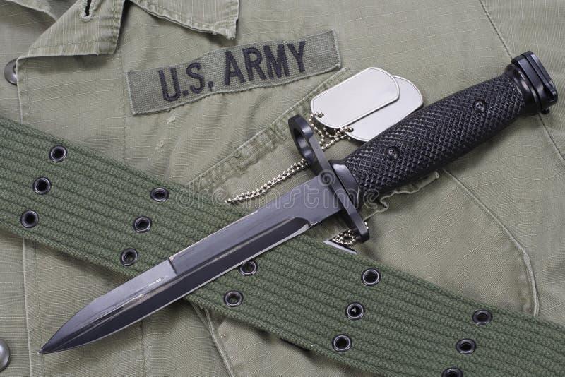 M16 rifle bayonet on uniform. Background royalty free stock images