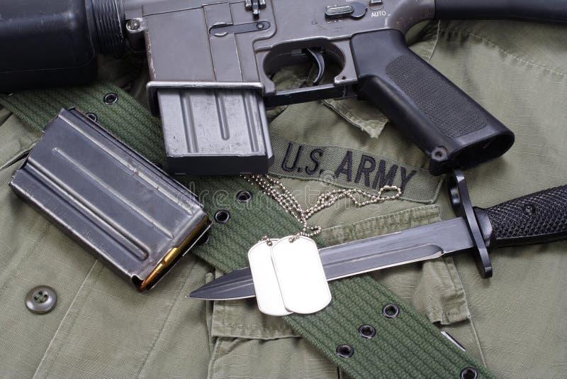 M16 rifle bayonet on uniform. Background stock photo