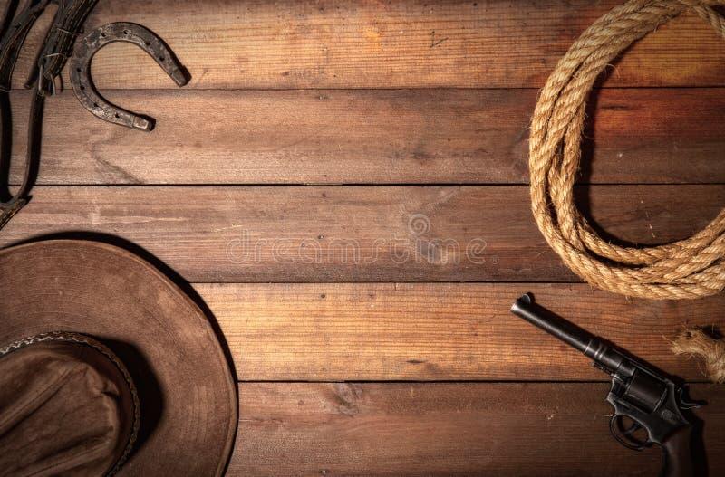 M?rk cowboybakgrund arkivfoto