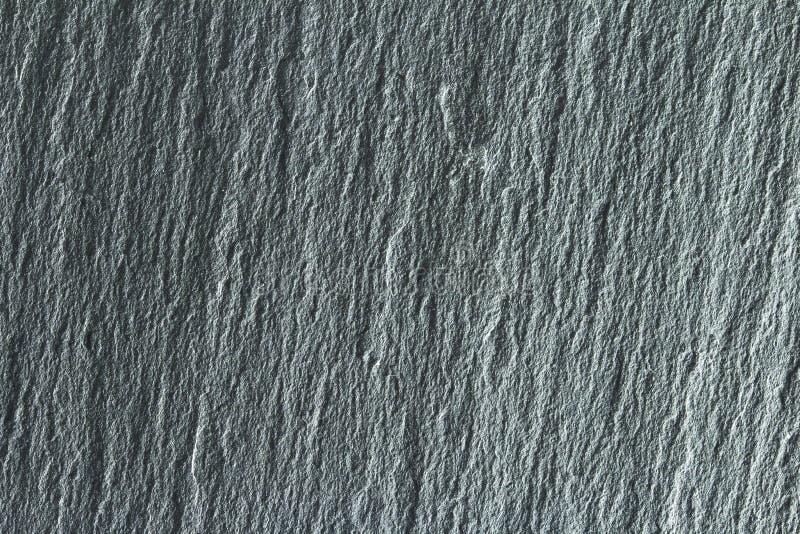 M?rk gr? f?rgsvart kritiserar bakgrund eller textur arkivbilder