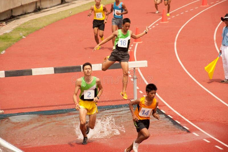 3,000 m.SC in Thailand Open Athletic Championship 2013. PHATUMTANI,THAILAND-SEPTEMBER,6 : Groups of men player action 3,000 m.SC in Thailand Open Athletic stock photography