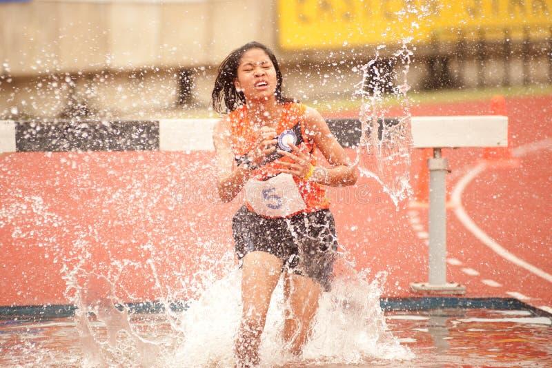 3,000 m.SC in Thailand Open Athletic Championship. PHATUMTANI,THAILAND-SEPTEMBER,6 : Supatcha Suvannabauorung player action 3,000 m.SC in Thailand Open Athletic stock photography