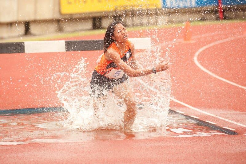 3,000 m.SC in Thailand Open Athletic Championship. PHATUMTANI,THAILAND-SEPTEMBER,6 : Supatcha Suvannabauorung player action 3,000 m.SC in Thailand Open Athletic stock images