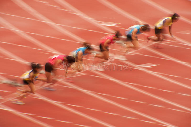 100m.in Thailand Open Athletic Championship 2013. PHATUMTANI,THAILAND – SEPTEMBER,6 : Groups of women player action of 100 m. in Thailand Open Athletic stock images