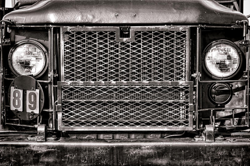 M35 United States Army Cargo Truck Front Grille. M35 type United States Army two and a half tons military cargo truck front grille and headlamps know as deuce stock image