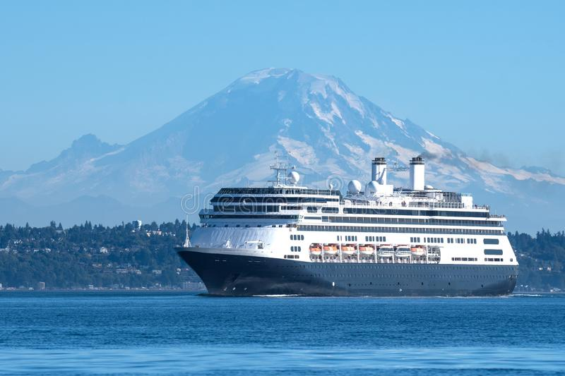 M/V Amsterdam transiting Shilshole Bay. Holland America Line`s M/V Amsterdam leaving Seattle on her way to Alaska with Mount Rainier in the background royalty free stock photography