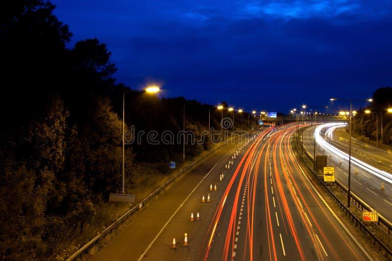m6机动车路晚上 免版税库存照片