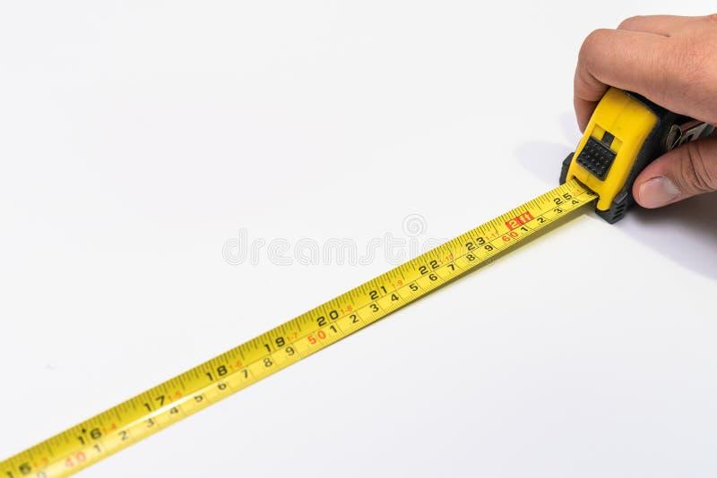 Maßband auf weißem Hintergrundabschluß oben stockfoto