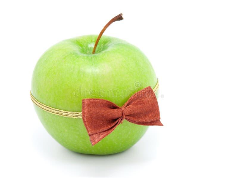 Download A Maçã Verde Com Curvar-amarra Foto de Stock - Imagem de acessório, curva: 16858324