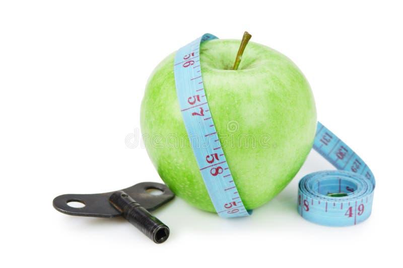 maçã verde e medida azul da fita com indício isolada fotos de stock