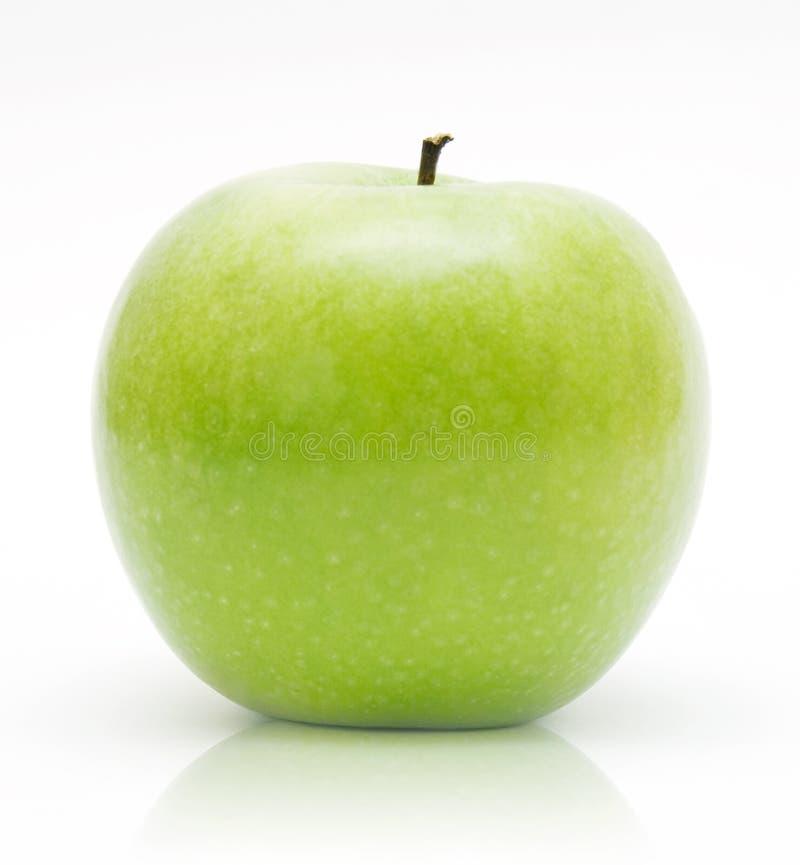 Maçã verde no branco fotografia de stock royalty free