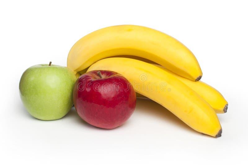 Maçãs e bananas vermelhas e verdes imagens de stock royalty free
