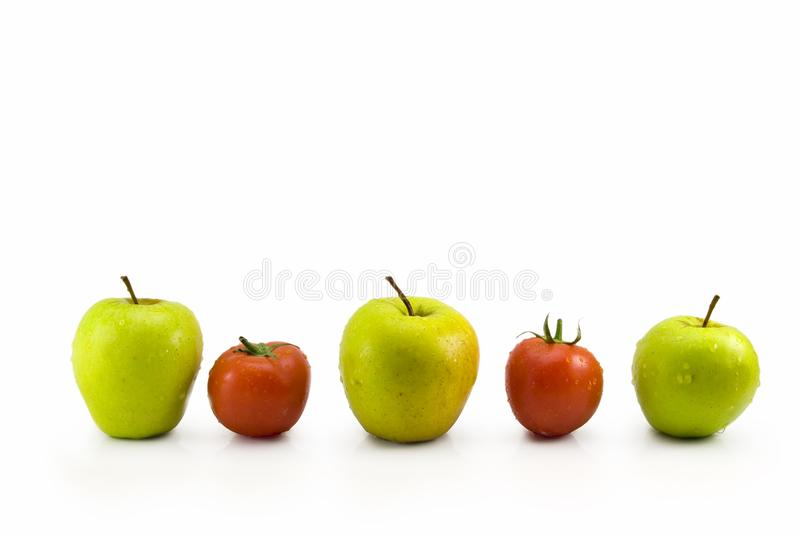 Maçãs e tomates fotografia de stock royalty free