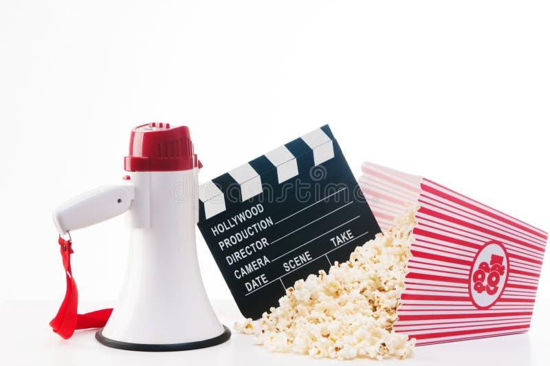 Maïs coloré de concept-bruit de cinéma, bobine de film, panneau de clapet, images stock