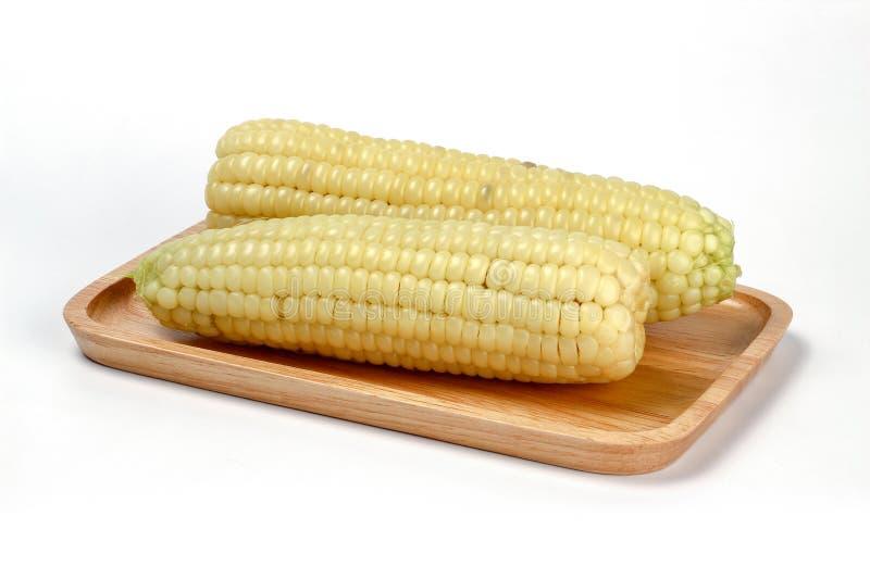 Maïs de plat en bois, maïs cireux image libre de droits