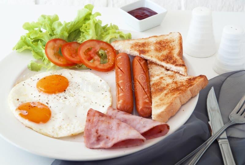 Mañana del jamón de la salchicha del huevo del desayuno foto de archivo