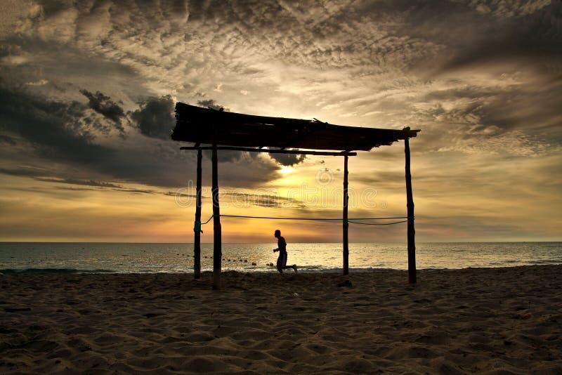 Mañana en playa imagenes de archivo