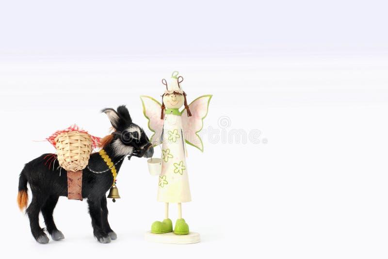 Mała anioł postać odizolowywająca na białym tle Zabawka w górę fotografia stock