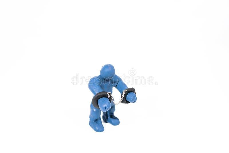 Mała błękitna postać w kajdankach Robić od sztuki gliny obraz royalty free