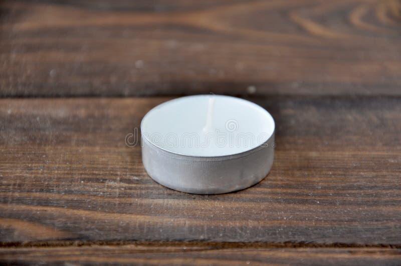 Mała biała świeczka - pastylka fotografia stock