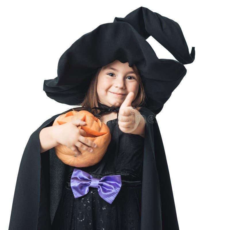 Mała czarownica pokazuje aprobaty zdjęcie stock