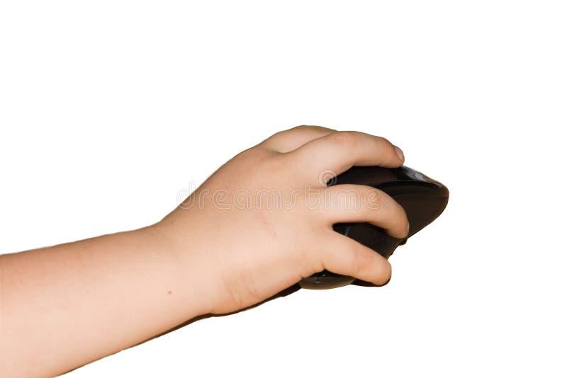 Mała dziecka ` s ręka trzyma czarnej komputerowej myszy obrazy royalty free