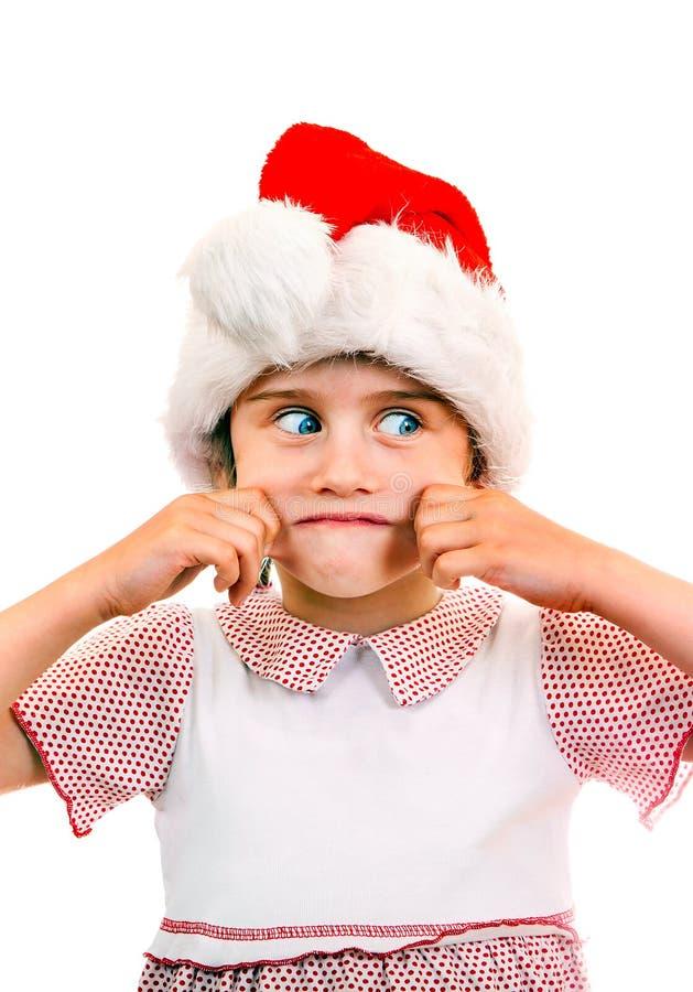 Mała dziewczyna w Santa kapeluszu zdjęcia royalty free