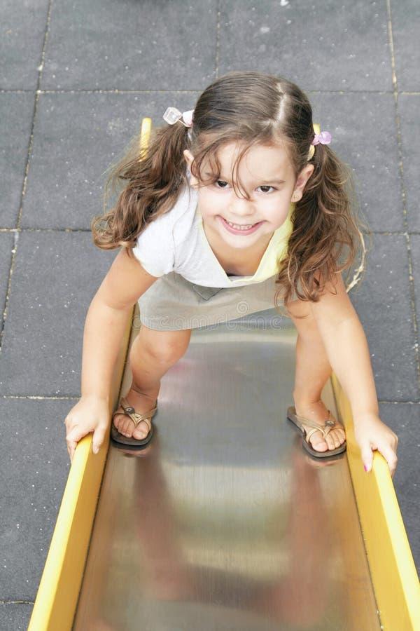 Mała dziewczynka na suwaku zdjęcia stock