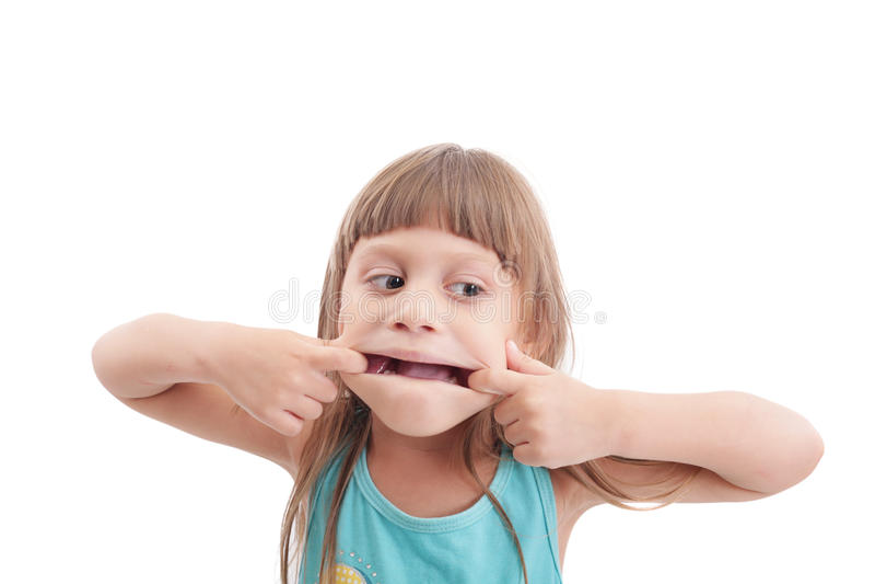 Mała dziewczynka robi dziwacznej twarzy obraz royalty free