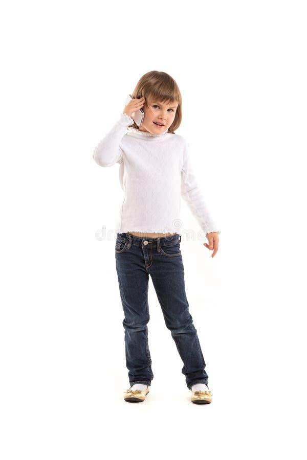 Mała dziewczynka robi rozmowie telefonicza zdjęcie stock