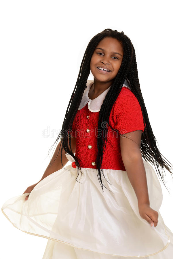 Mała dziewczynka taniec w partyjnej sukni fotografia stock