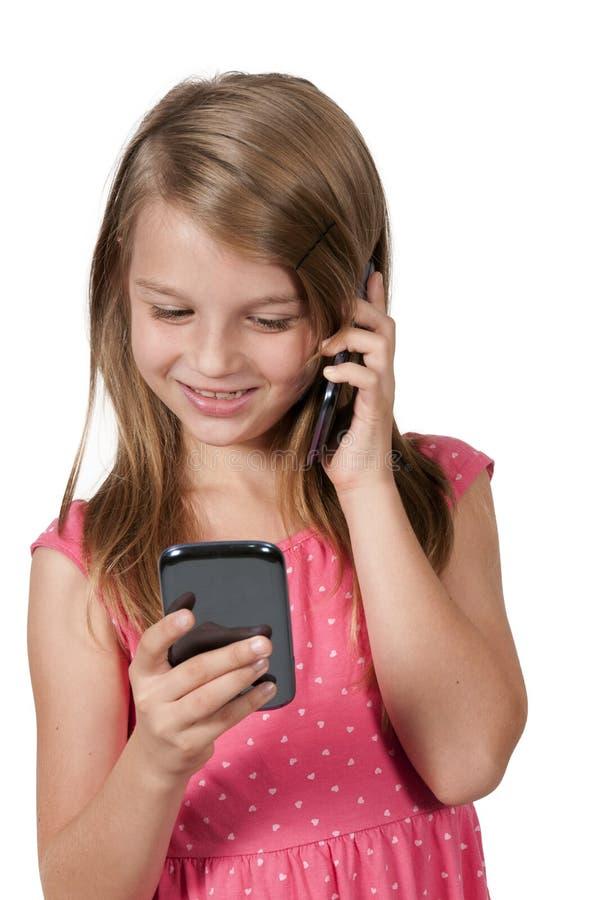 Mała Dziewczynka Używa telefony komórkowych zdjęcia stock