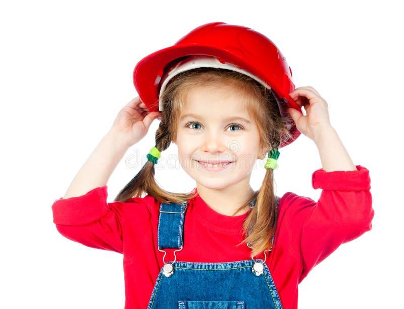 Mała dziewczynka w budowa hełmie obraz stock