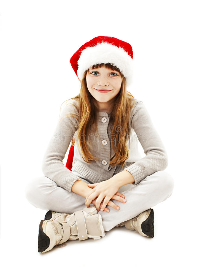 Mała dziewczynka w czerwonym Santa kapeluszu obrazy stock