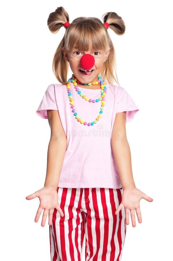 Mała dziewczynka z błazenu nosem obraz stock