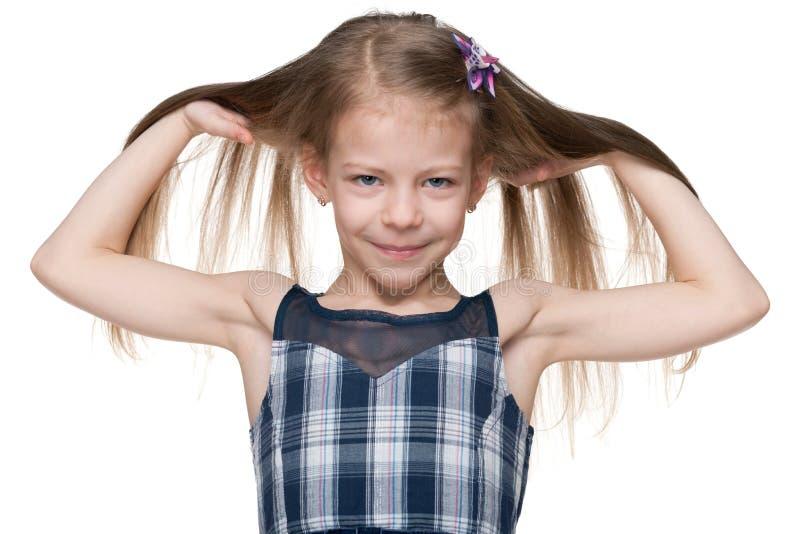 Mała dziewczynka z bieżącym włosy obrazy royalty free