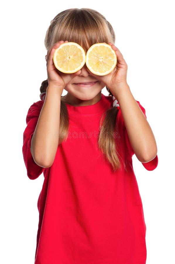 Mała dziewczynka z cytryną zdjęcia stock