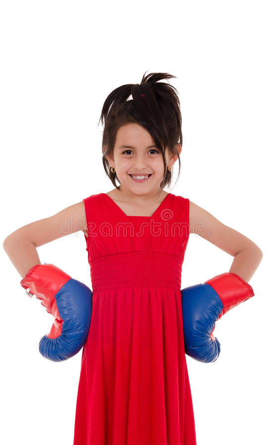 Mała dziewczynka z czerwonymi i błękitnymi bokserskimi rękawiczkami zdjęcia stock