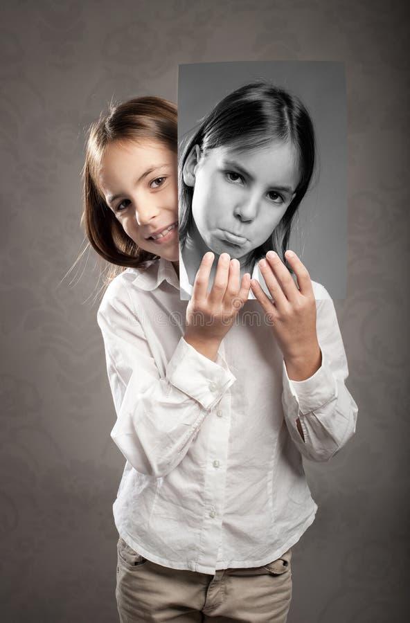 Mała dziewczynka z dwa twarzami zdjęcia royalty free