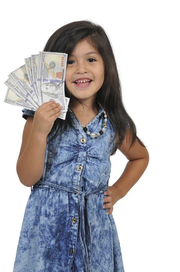 Mała dziewczynka z gotówkowym pieniądze obraz stock