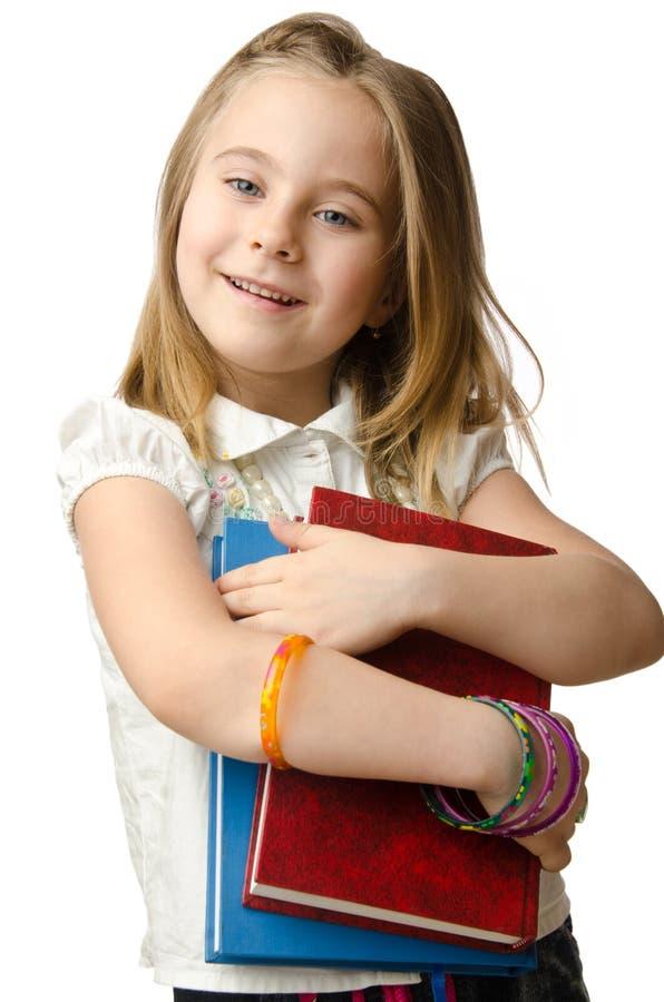 Mała dziewczynka z książkami obrazy royalty free