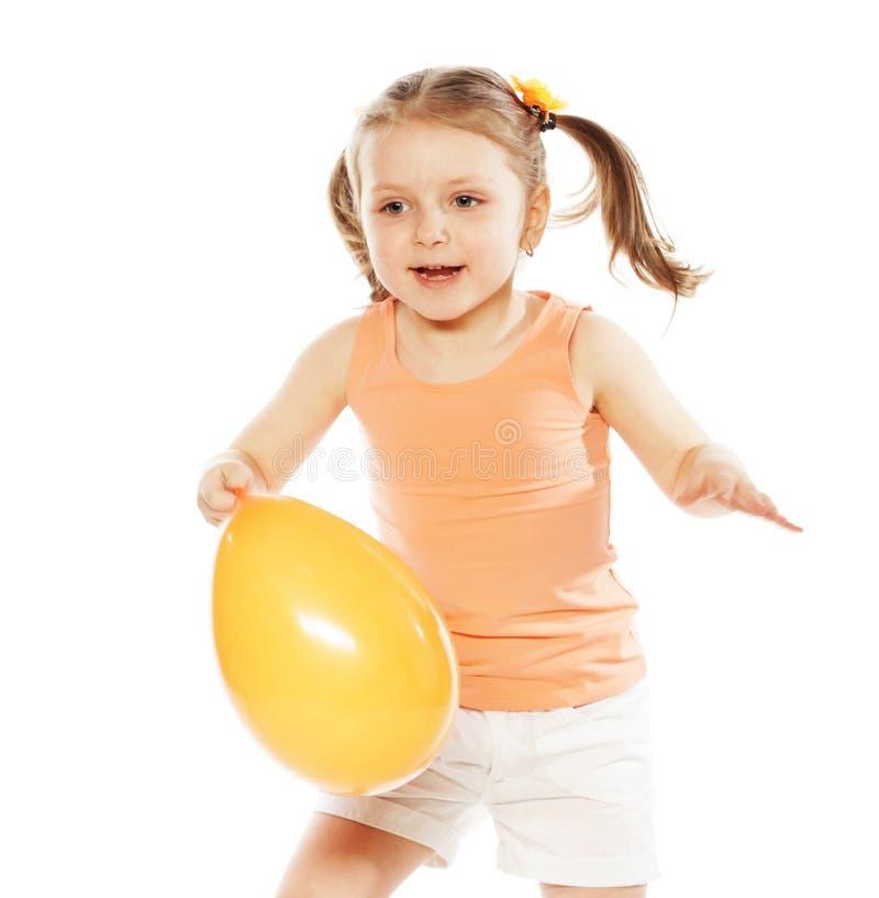 Mała dziewczynka z pomarańczowym balonem fotografia stock