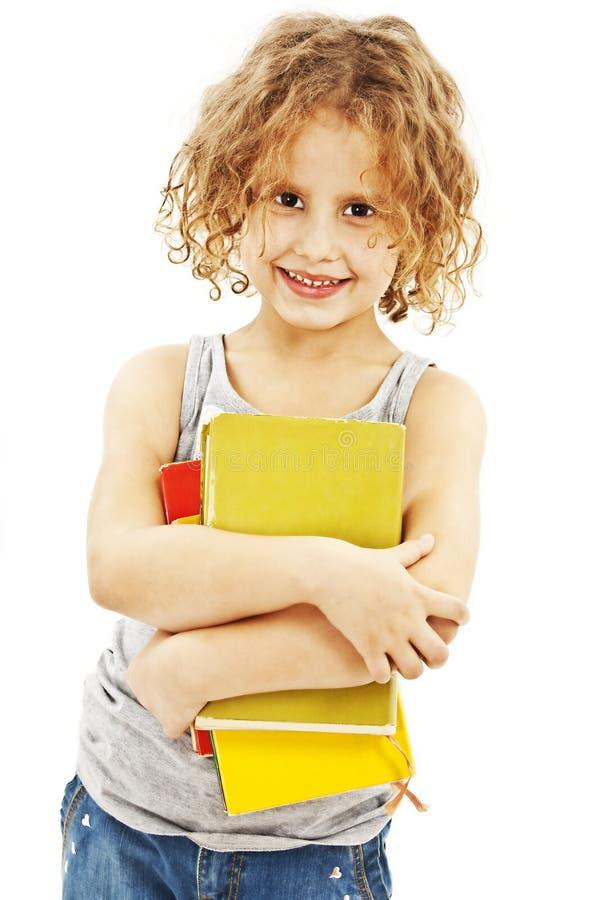 Download Mała Kędzierzawa Dziewczyna Z Książkami Obraz Stock - Obraz złożonej z sztuka, piękno: 28957855