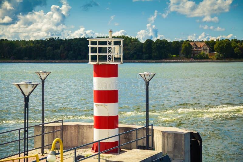Mała pasiasta latarnia morska w Klaipeda fotografia royalty free