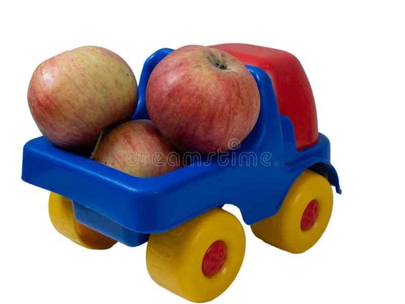 Mała zabawkarska samochód ciężarówka z jabłko owoc zdjęcia stock